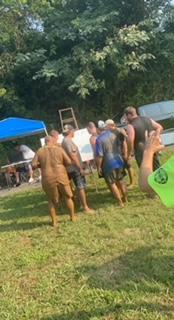 Muddy officers posing