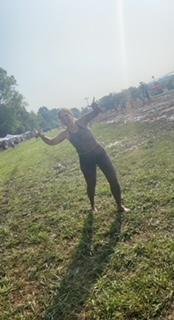 Muddy officer posing