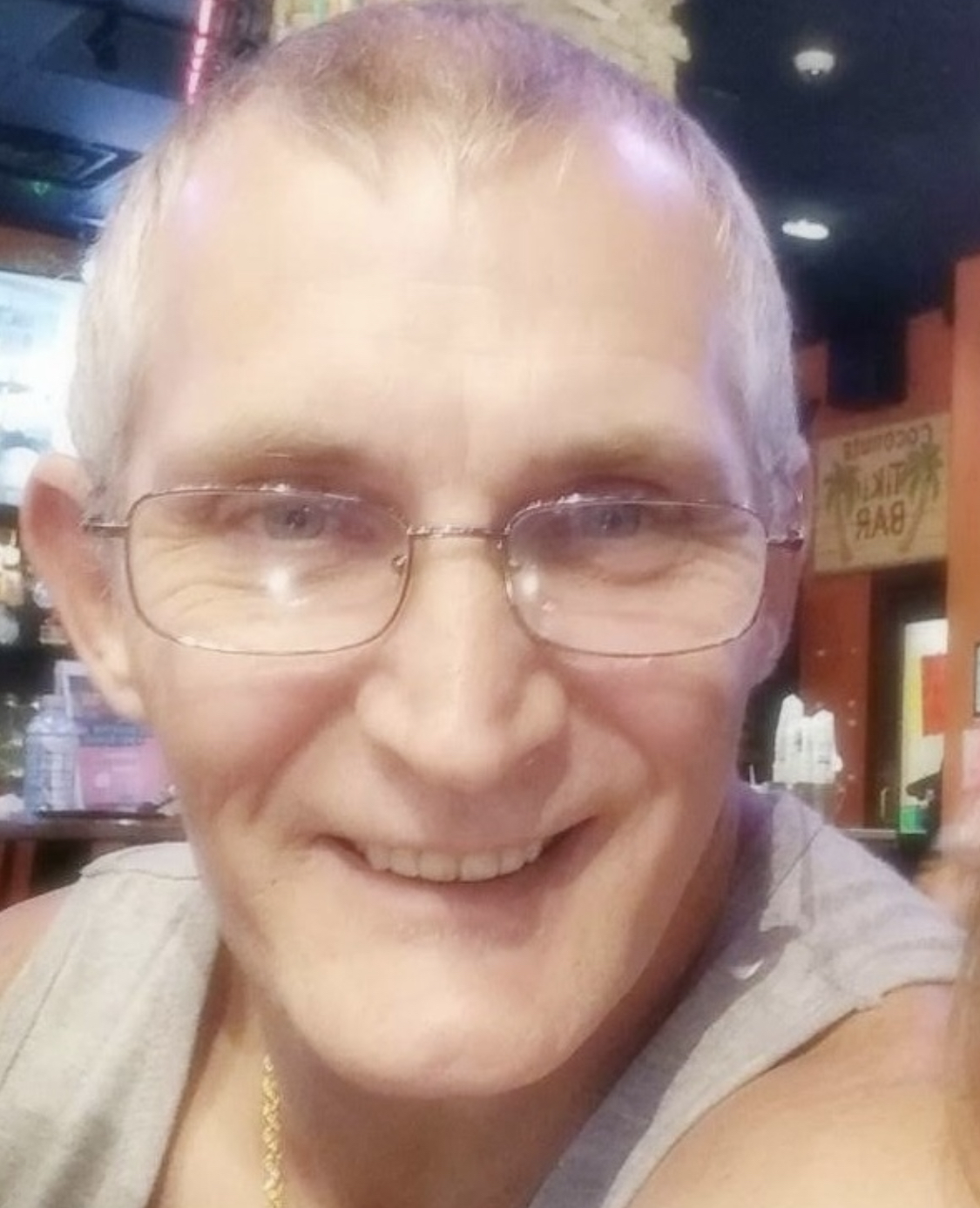 Elderly white male with glasses