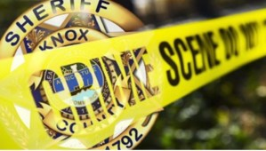 Crime scene tape with KCSO badge background