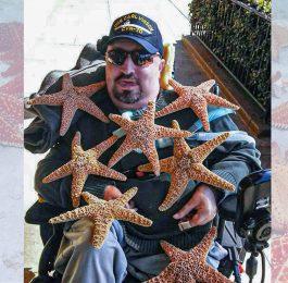 Дайвер инвалид на инвалидной коляске