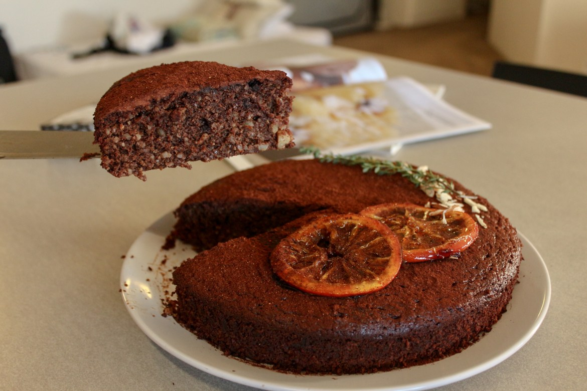 slicing a piece of chilli choc orange cake