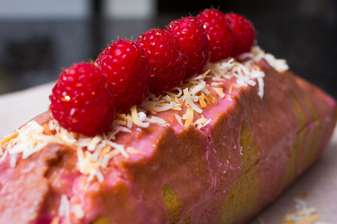 Raspberries on Raspberry Triple Coconut Loaf Cake