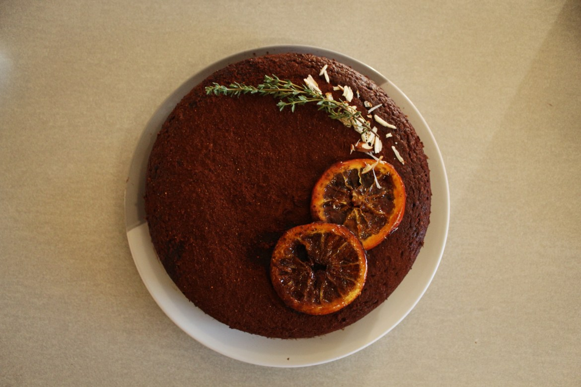 Flat lay of Flourless Chilli Almond Orange Chocolate Cake