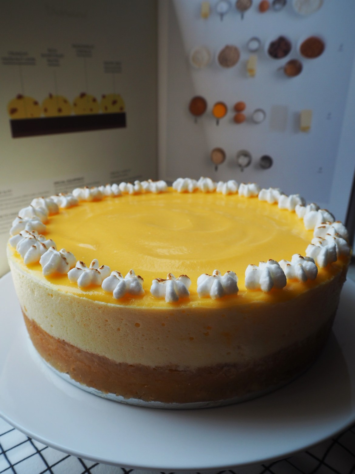 Lemon Curd Meringue Mousse Cake with Macadamia Crust top view