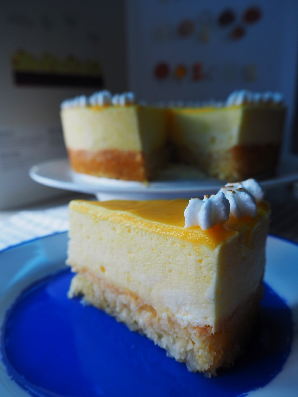 Freshly sliced Lemon Curd Meringue Mousse Cake with Macadamia Crust