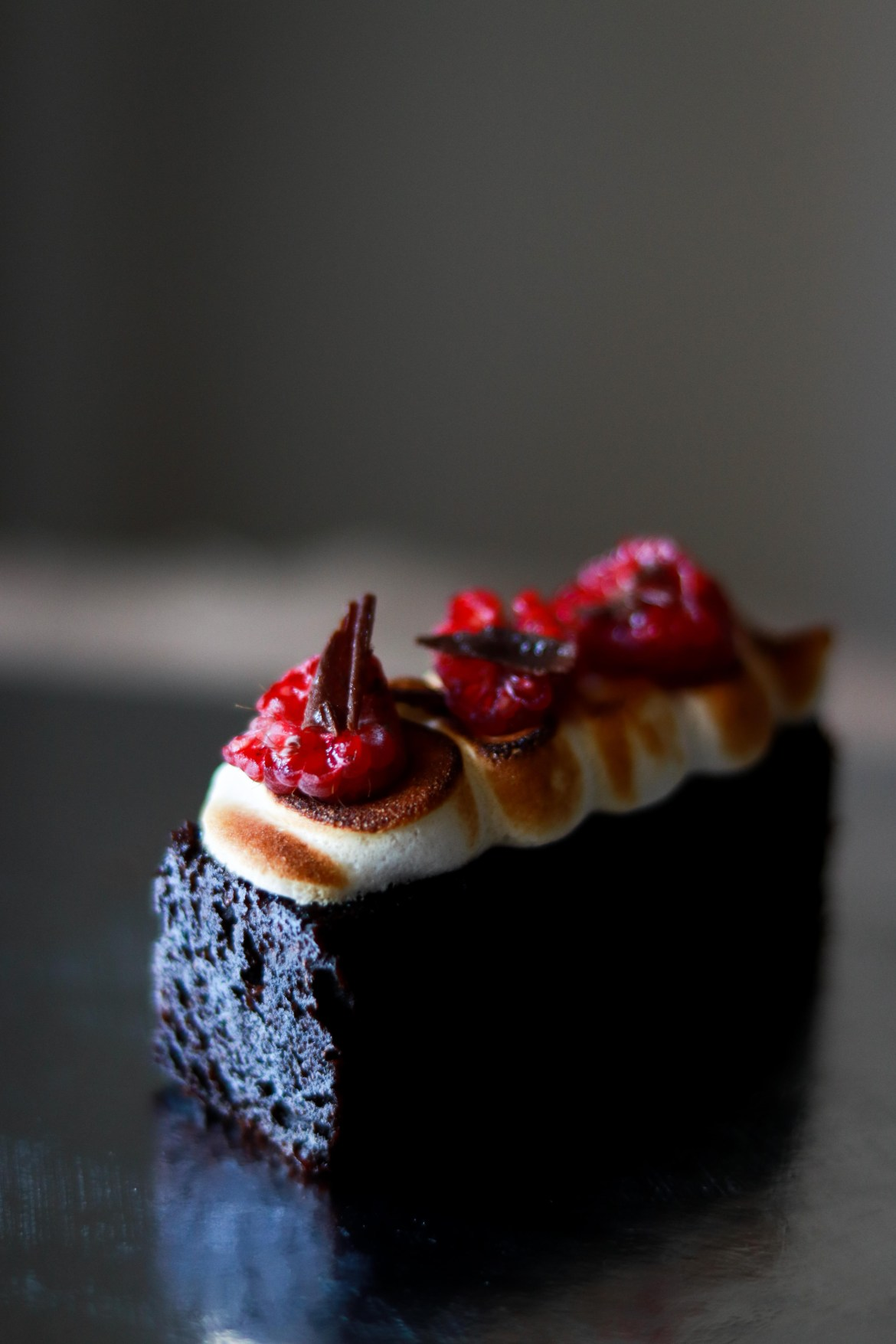 Chocolate_sour_cream_cake_with_meringue_raspberry_and_shaved_chocolate3