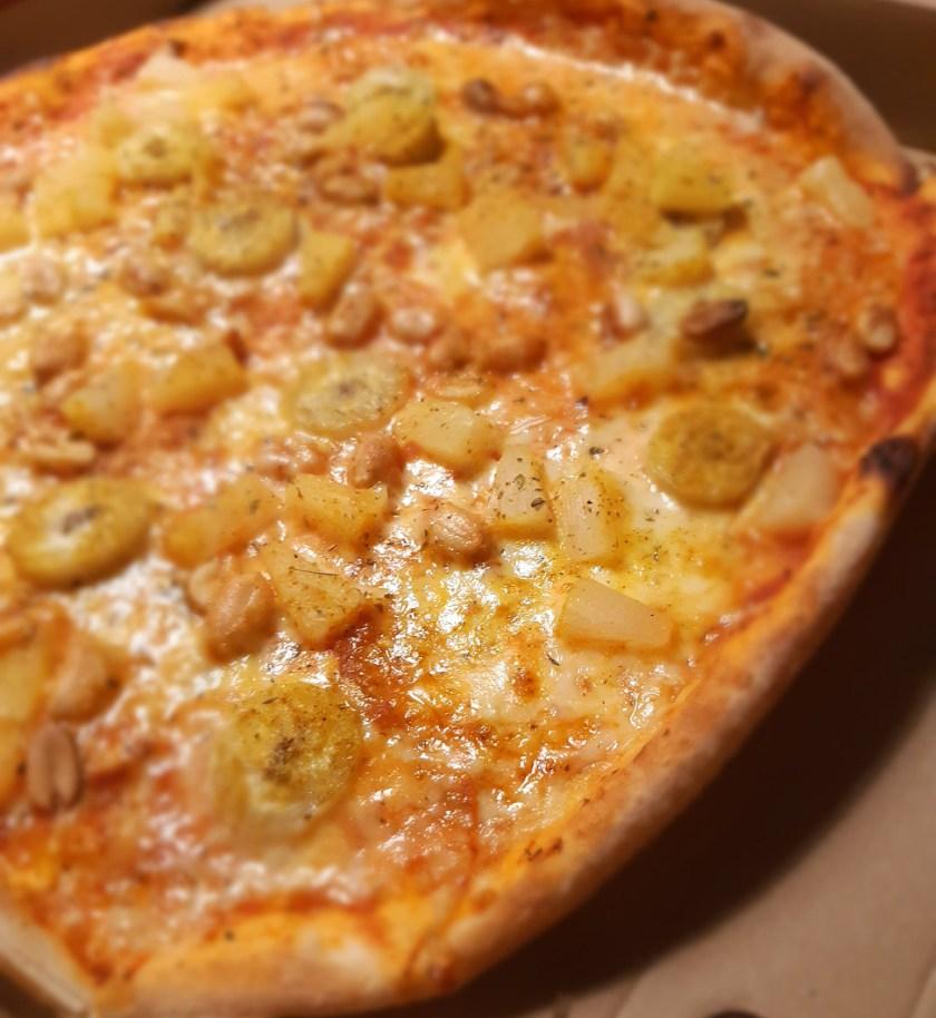 Pineapple, banana, and peanut pizza