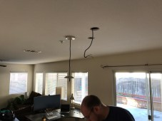 We just ran the lamp's cable through to the other side and connected it there!