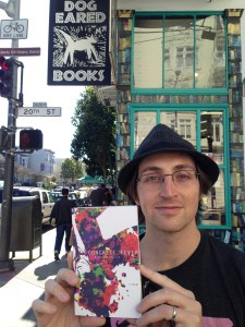 Author Nathaniel Kressen with his hand-bound novel, Concrete Fever.