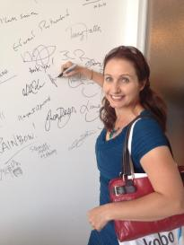 Joanna signs Kobo's Author Wall of Fame.