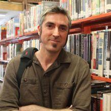 A headshot of David Mark Brown.