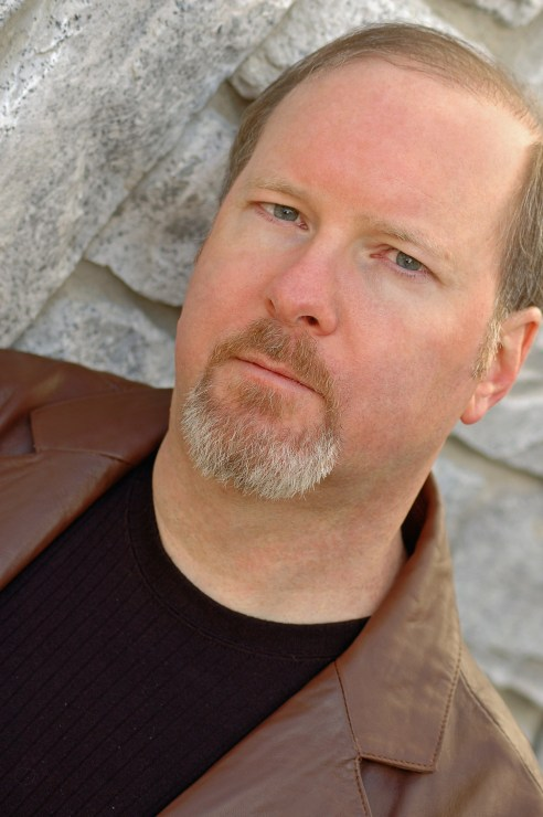 A headshot of Kevin J. Anderson.