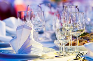 catering table set service with silverware, napkin and glass at