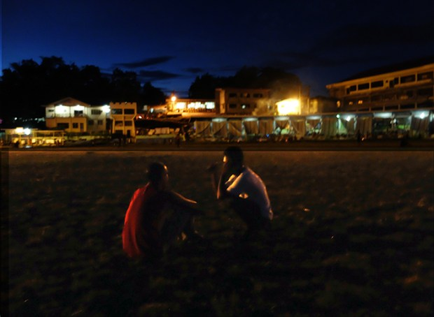Nighttime at Surigao del Sur's Sports Center, site of yet another mass evacuation of thousands of Manobos driven from their homes by brutal anti-insurgency campaigns of the Armed Forces of the Philippines.  The province's Social Hall may be seen in the background (3rd building from the left).