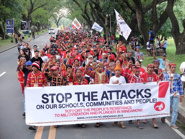 The Lumad as they reach UP's Faculty Center.