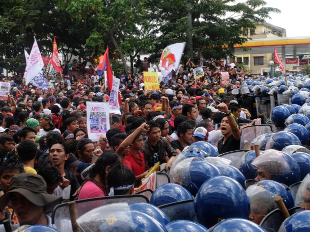 """The """"battle"""" finally stopped after the police agreed to allow the protesters to hold their program at the site, several kilometers away from Liwasang Bonifacio where APEC security plans wanted to """"contain"""" the protests."""