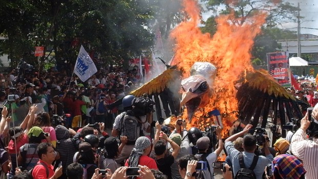 The 'imperialist vulture' burns as the protest rally reaches its end.