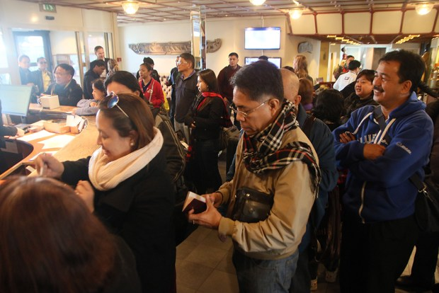 Ready for the talks. Peace workers queue at the reception area of the Holmen Fjordhotell in Asker, Oslo, Norway.
