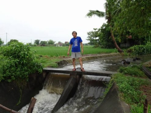 Photographer Lito Ocampo at an irrigation canal.