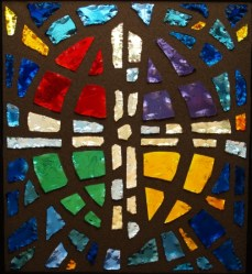 picture of stained glass ELCA logo located in KOG Narthex