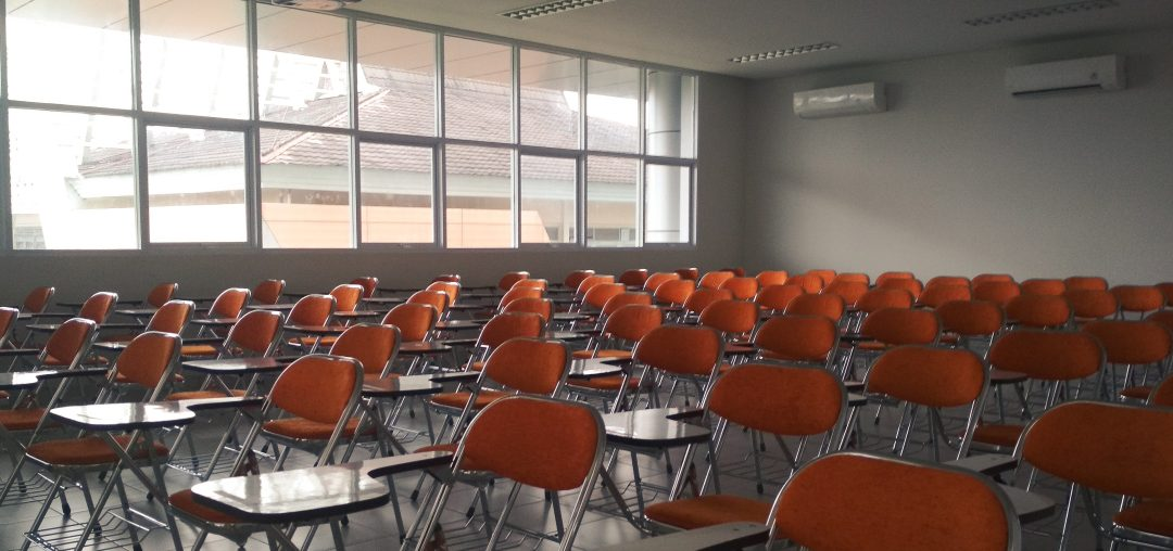 Empty classroom with orange chairs