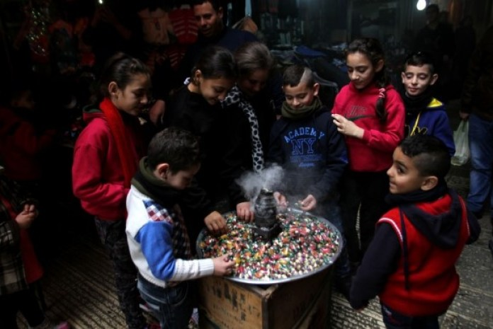 Sweets are widely distributed among the children during Mawlid celebrations in Nablus, Palestine. (Getty Images)