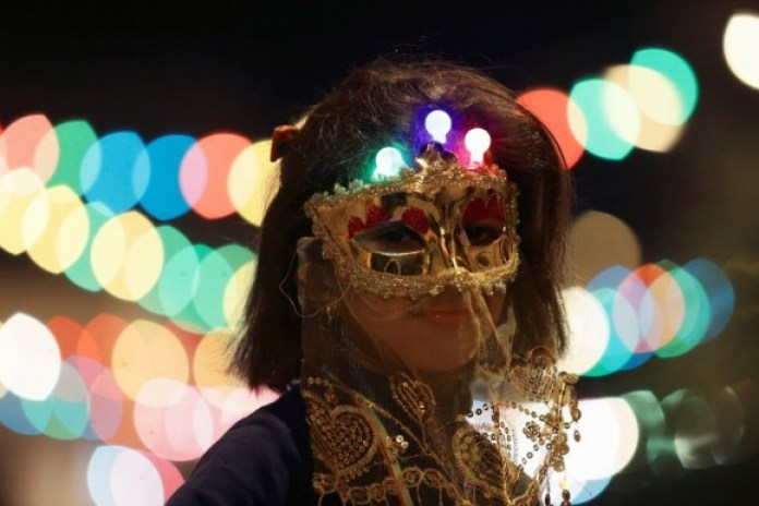 A girl wearing a mask participates in a procession celebrating the religious holiday of Mawlid in Benghazi, Libya. (Reuters)