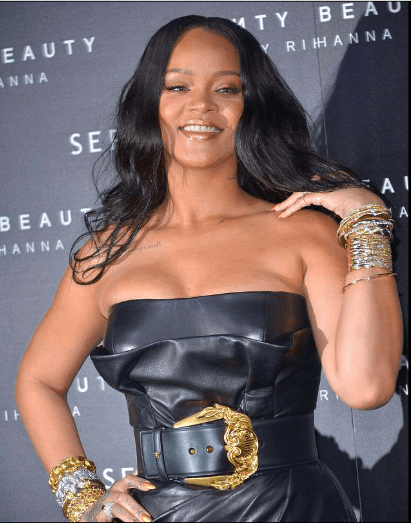 Style Stalking: Rihanna Wows In Cleavage-Baring leather Dress For Fenty Beauty Launch In Italy 2