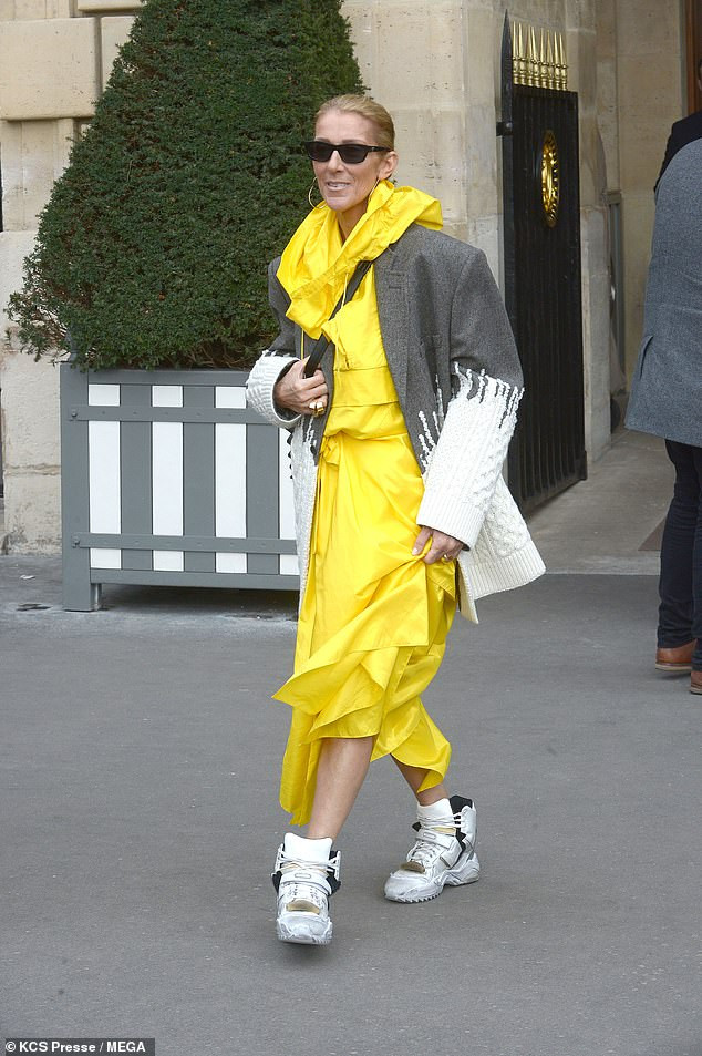 Celine Dion Makes Another Strong Fashion Statement In Yellow Coat, Hybrid Jacket And Gold Trainers 1