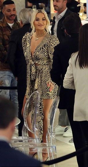 Rita Ora Flaunts Ample Cleavage In Plunging Animal Print Dress 1