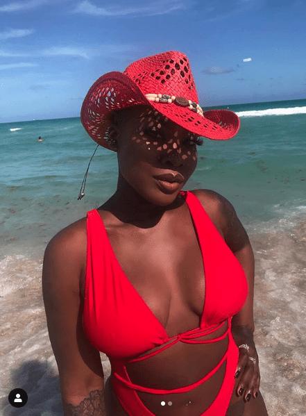 Sun, Sea And Swimwear: Charly Boy's Daughter, Dewy Oputa Sizzles In Red Swimwear 3