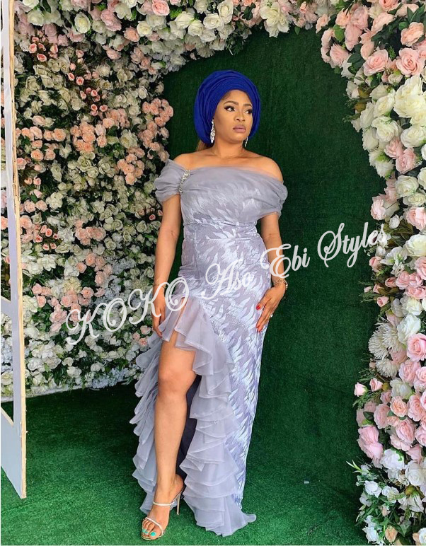 Slay Your Queenship In These Daring Slit Aso Ebi Styles 3