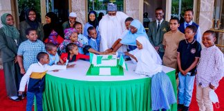 President Buhari and Children at the 2021 World Children Day