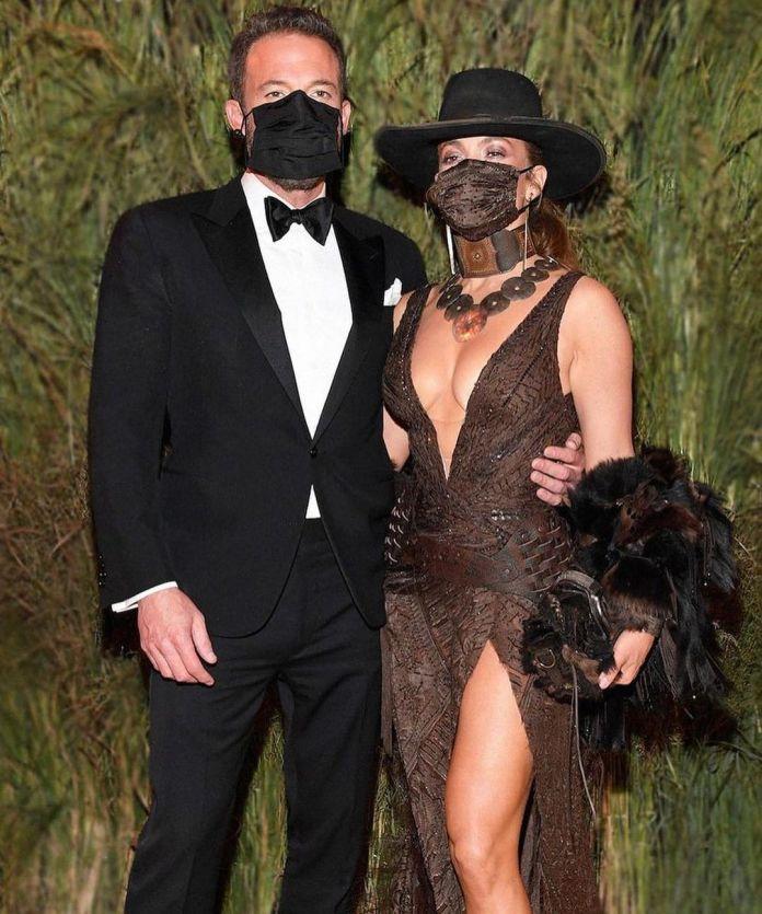Jennifer Lopez And Ben Affleck Share A Mask Kiss At The Met Gala