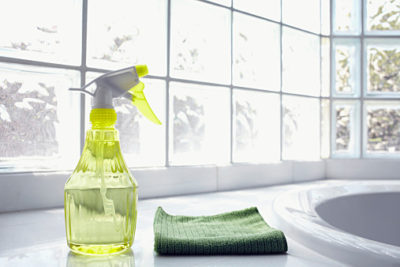 USA, New York State, New York City, Brooklyn, Cleaning supplies in front of glass brick wall