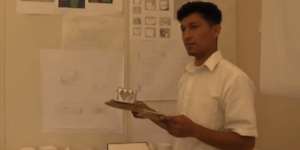 Brandon speaks to his class about an architecture project. Photo by: Cristal Corrales.