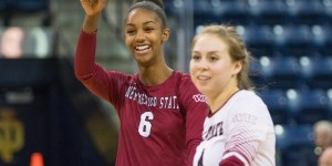 NMSU volleyball players Tatyana Battle, left, and Ariadnne Sierra appear at a match earlier this season at Notre Dame University in South Bend, Indiana. Battle hit a season-high 19 kills on .436 hitting. (Photo by Mike Miller courtesy of NMSU athletics)