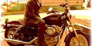 Amy Britt AKA James Buchanan poses on a motorcycle (Photo courtesy of James-Buchanan.com)