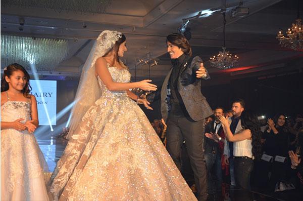 امينة خليل تتألق بفستان العروس في دفيليه البحيري لشتاء 2017