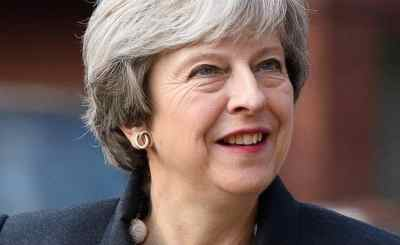 UK's May Fires Defence Minister