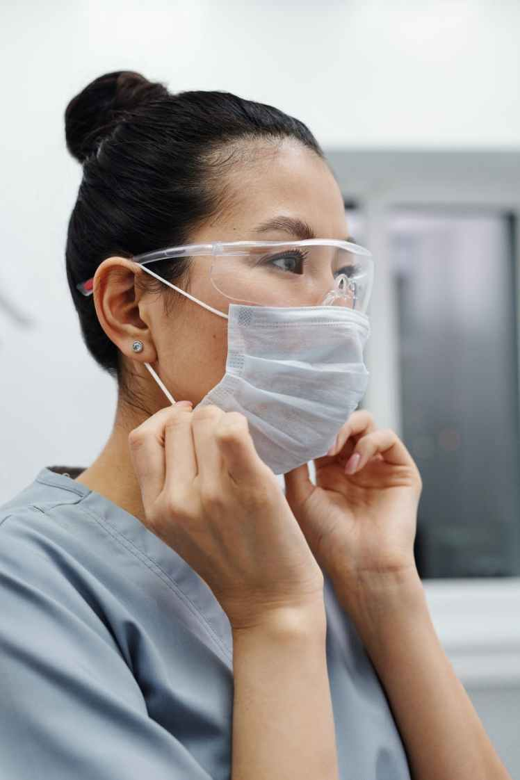 photo of woman wearing protective goggles and mask
