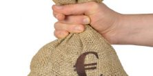 Hand giving bag with euro symbol isolated on white