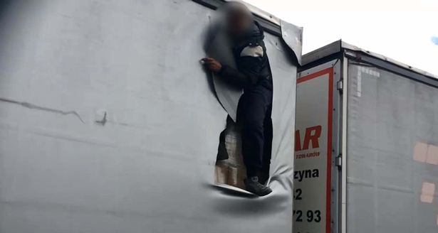 immigrant tears a hole in the the fabric of the lorry container2.jpg