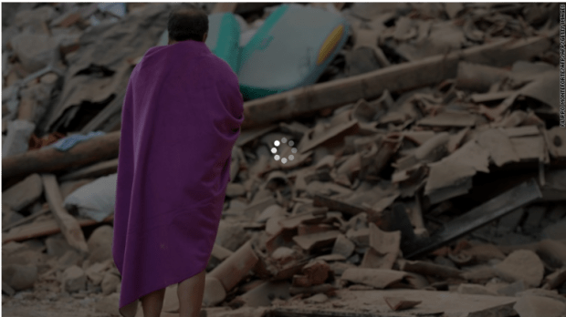 Italian earthquake 24:A victim surveys the quake debris.png