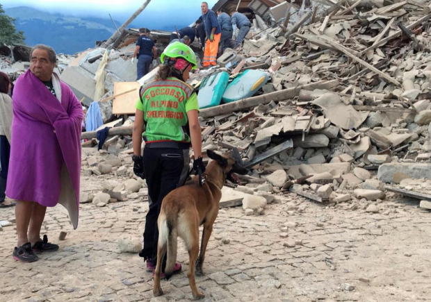 Italian Earthquake5: Survivors and Rescuers going through the rubble