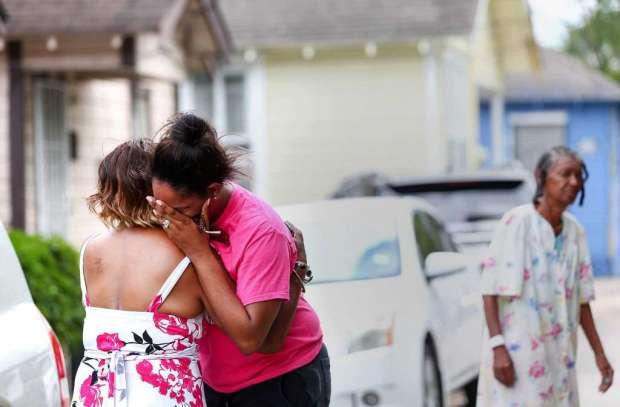 Marketta Smith, aunt of two children weeps