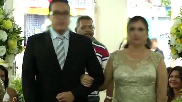 the-bride-and-groom-to-be-walk-down-the-aisle-dos-santosfollows-closely-behind
