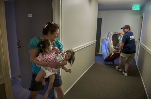 Aida and her girls settle into their new apartment in Palo Alto in October. Aida has struggled to care for the twins in their temporary home while husband, Arturo, stayed back in the Sacramento area for work.jpg