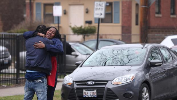 Mother of Raheem and Dillon Jackson being comforted near the scene where four people, including her sons, were fatally shot in Chicago's South Shore neighborhood on March 30, 20172.jpg
